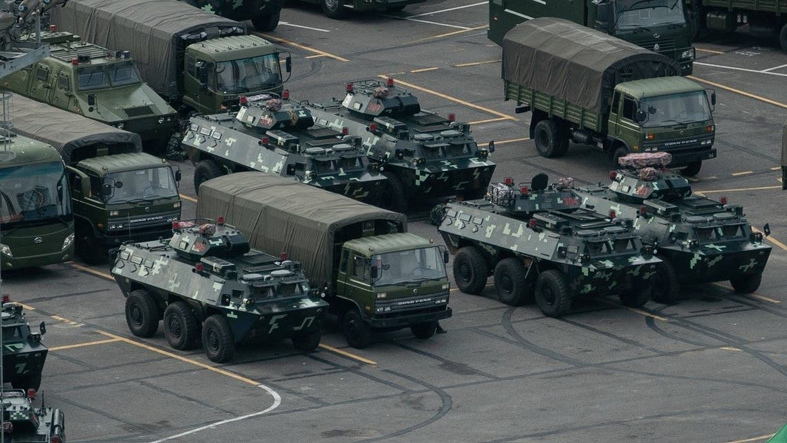 China beefed up its military presence by moving trucks and armored personnel carriers to the Shenzhen Bay stadium in Shenzhen, bordering Hong Kong, on August 16, 2019. (AFP)