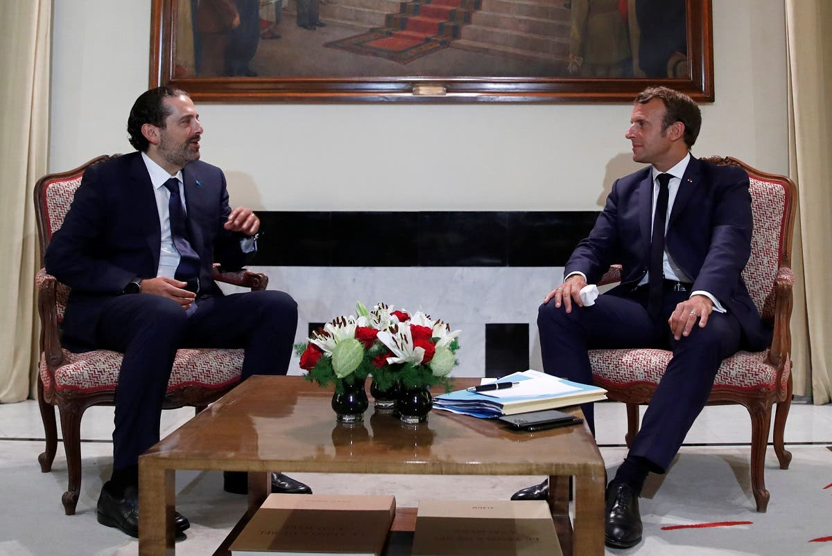 French President Emmanuel Macron meets former Lebanese Prime Minister Saad Hariri (L) at the Pine Residence, the official residence of the French ambassador to Lebanon, in Beirut, on August 31, 2020. (AFP)