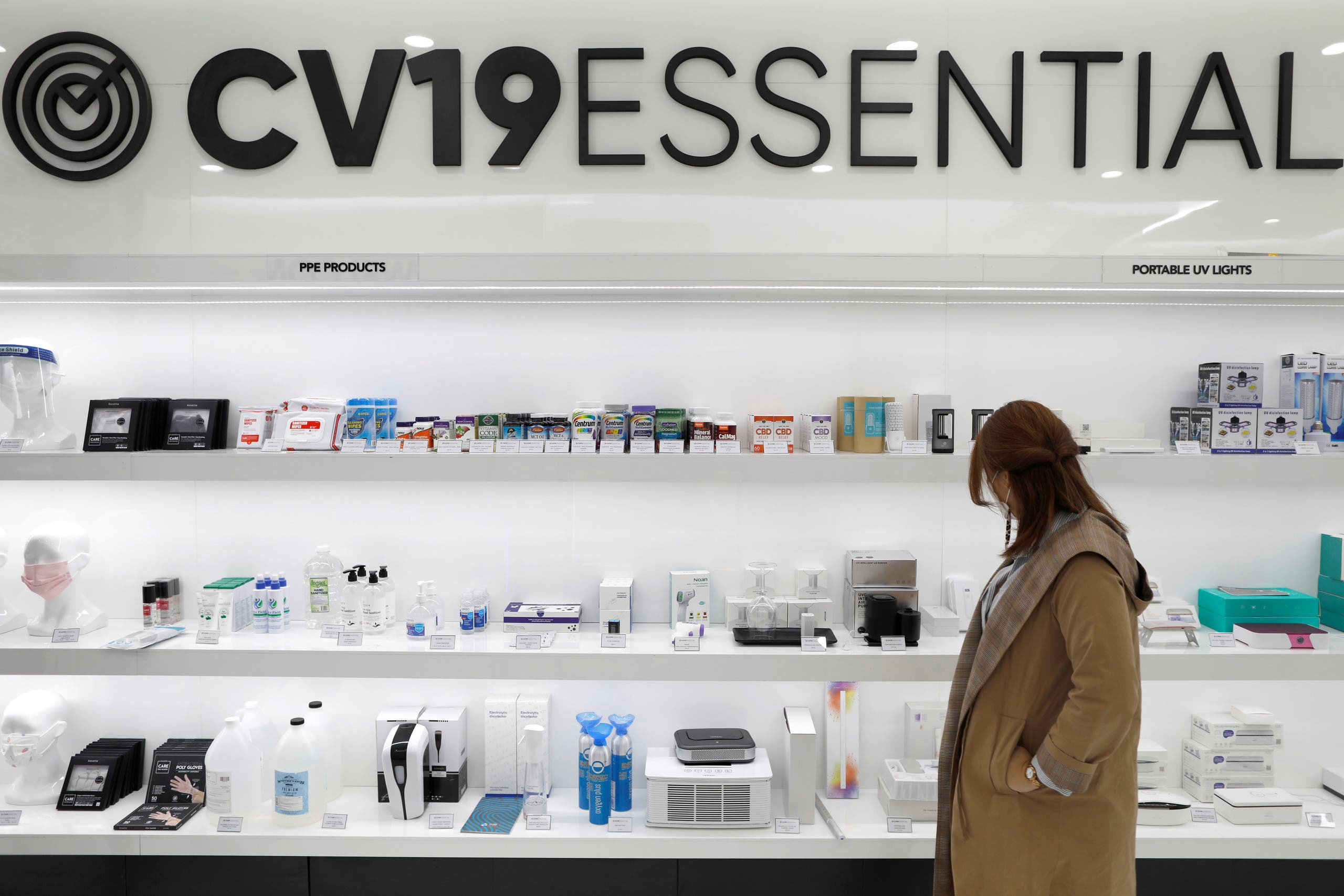 A person looks at the shop window at CV19ESSENTIAL in New York City, September 21, 2020. (Reuters)