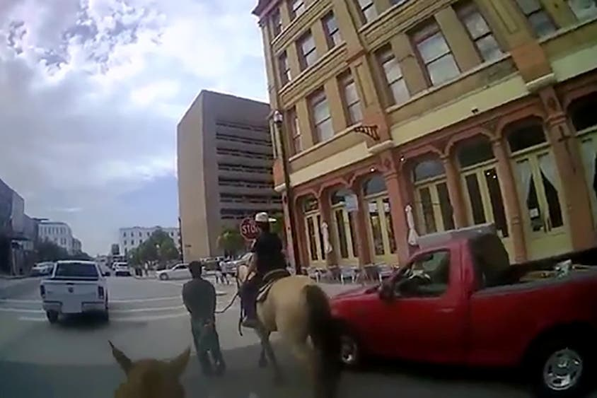 Police officer secures Donald Neely with a rope after she and another officer arrested the homeless man for criminal trespass in Texas, US, August 3, 2019, in a still image from video released October 2, 2019. (Reuters)