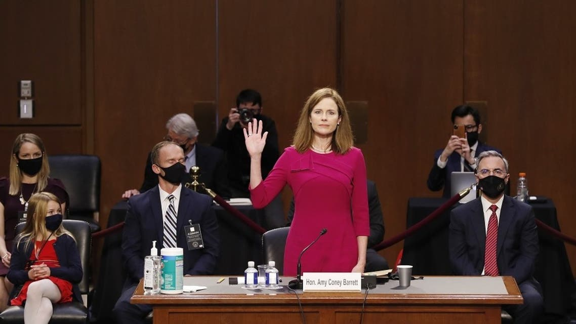 Supreme Court nominee Judge Amy Coney Barrett stands as she is sworn in during her confirmation hearing before the Senate Judiciary Committee, Oct. 12, 2020. (AFP)