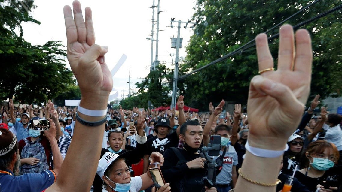 Pro-democracy protesters flash the three-fingers salute while attending a mass rally to call for the ouster of Prime Minister Prayuth Chan-ocha and reforms in the monarchy in front of parliament in Bangkok, Thailand. (Reuters)