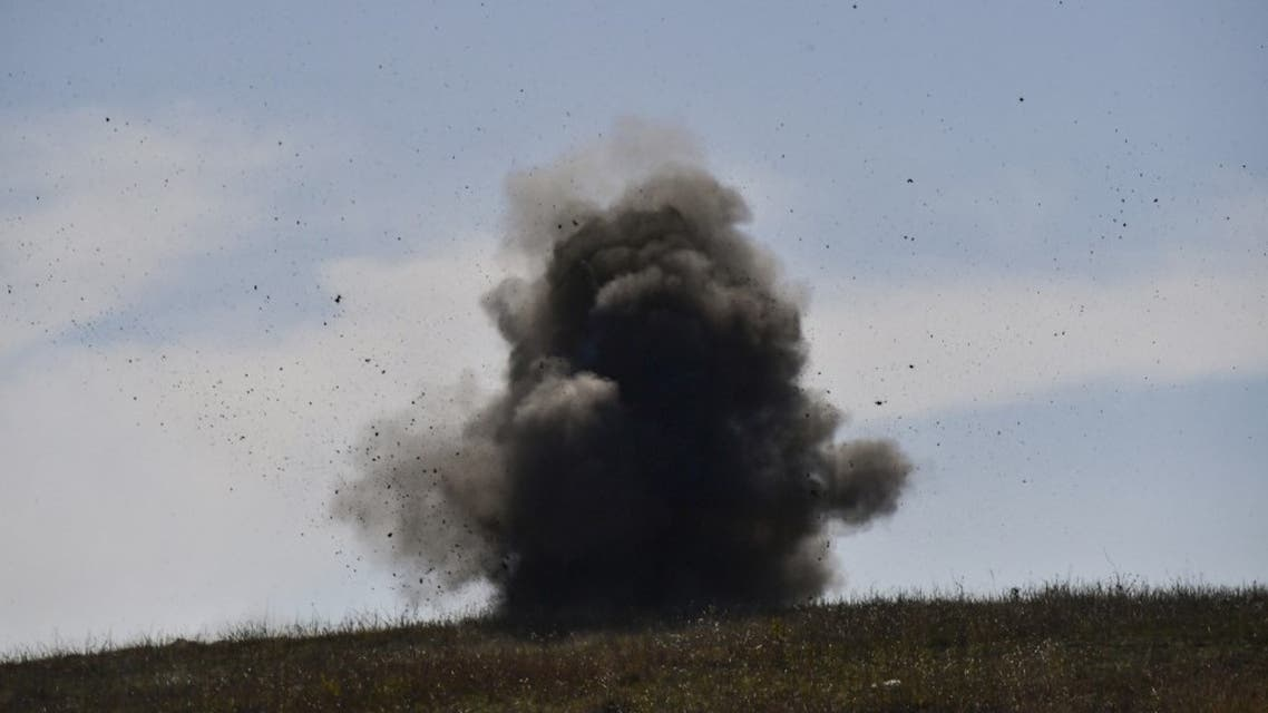 A controlled explosion of collected unexploded cluster bombs by members of a sapper group of the Karabakh Ministry of Emergency Situations on the outskirts of Stepanakert on October 12, 2020, during the ongoing military conflict between Armenia and Azerbaijan over the breakaway region of Nagorno-Karabakh. (AFP)