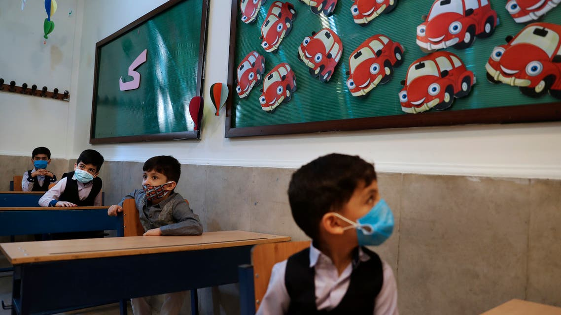 Students wearing protective face masks to help prevent spread of the coronavirus sit at their classroom after the opening ceremony of the Hashtroudi school in Tehran, Iran on Sept. 5, 2020. (File photo: AP)