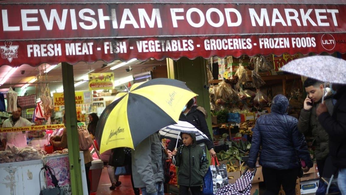 People shop at Lewisham Market amid the outbreak of the coronavirus disease (COVID-19) in London. (Reuters)