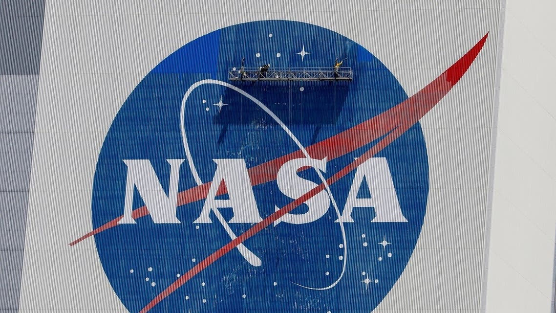 Workers pressure wash the logo of NASA on the Vehicle Assembly Building, in Cape Canaveral. (Reuters)