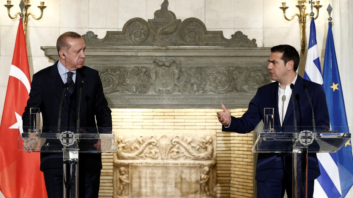 Greek Prime Minister Alexis Tsipras and Turkish President Tayyip Erdogan attend a press conference following their meeting at the Maximos Mansion in Athens, Greece December 7, 2017. (Reuters)