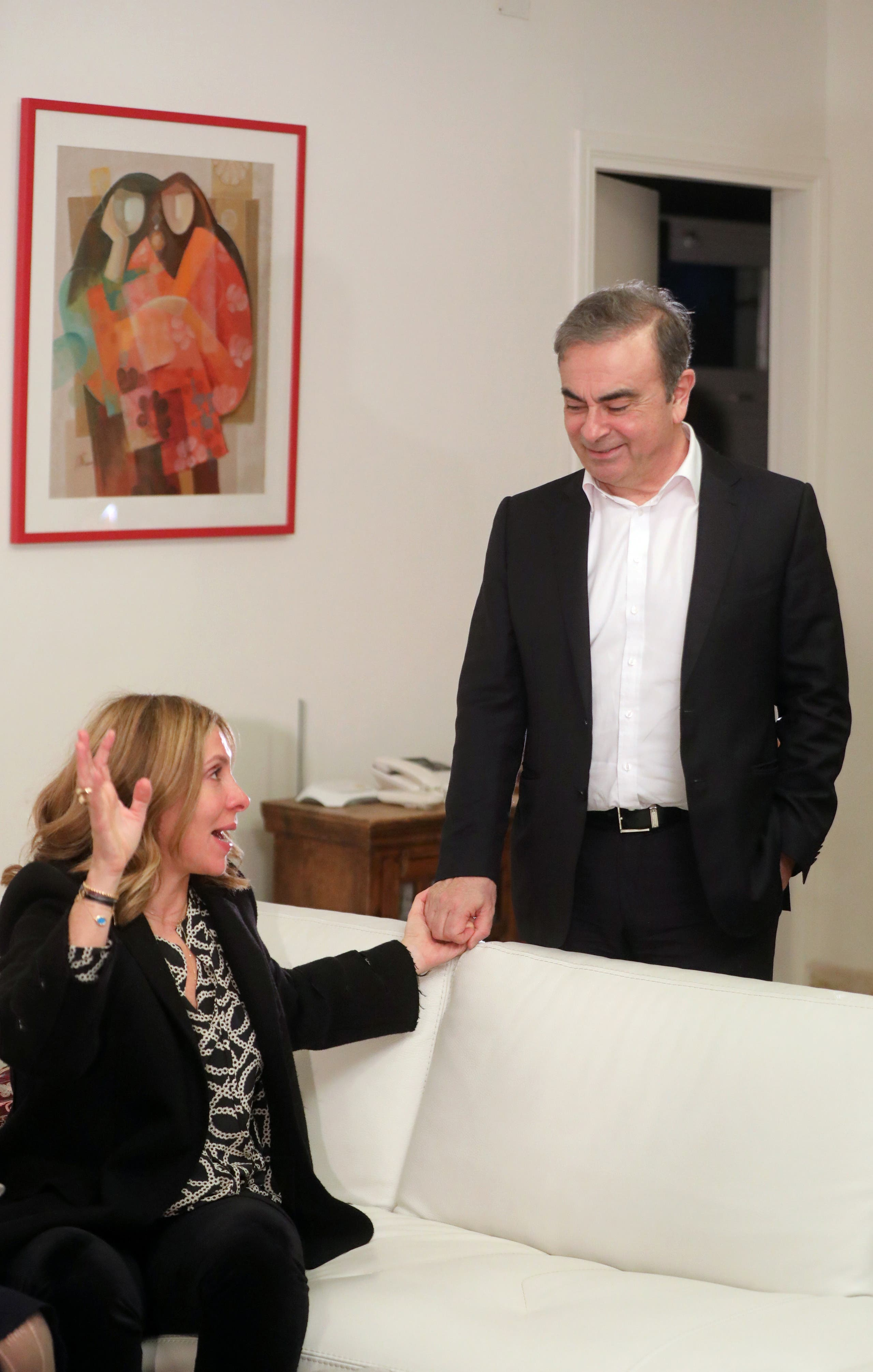 Former Nissan chairman Carlos Ghosn and his wife Carole Ghosn pose for a picture after an exclusive interview with Reuters in Beirut, Jan. 14, 2020. (Reuters)
