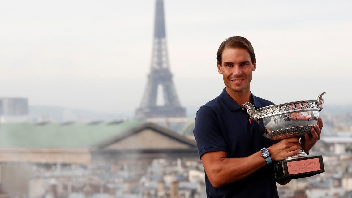 Spain's Rafael Nadal poses with the trophy after winning the French Open on October 12, 2020. (Reuters)_817753060_RC2VGJ96GIZ2_RTRMADP_3_TENNIS-FRENCHOPEN