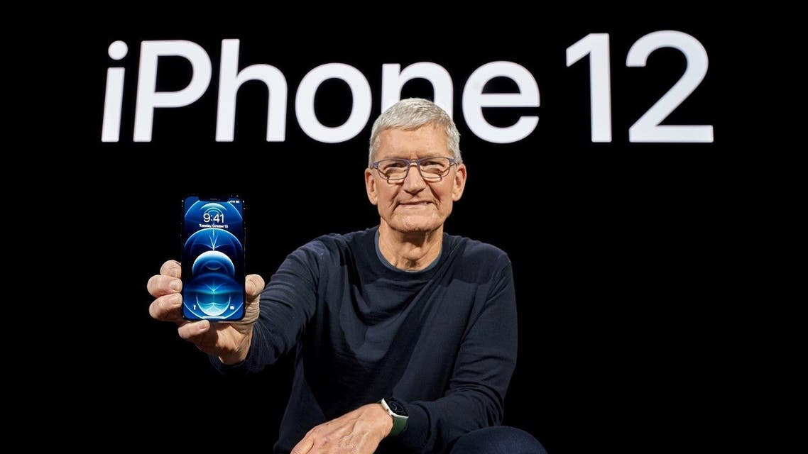 Apple CEO Tim Cook poses with the all-new iPhone 12 Pro at Apple Park in Cupertino. (Reuters)