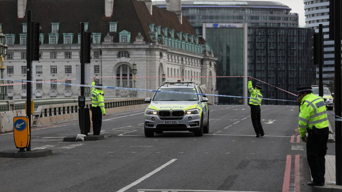 Police officers are seen at a closed off Westminster Bridge, in London, Britain October 13, 2020. REUTERS/Simon Dawson