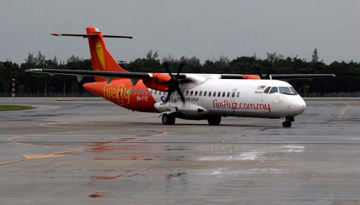 FireFly airline ATR 72-500 aircraft taxis to the airport terminal at Changi airport on a rainy day in Singapore. (Reuters)