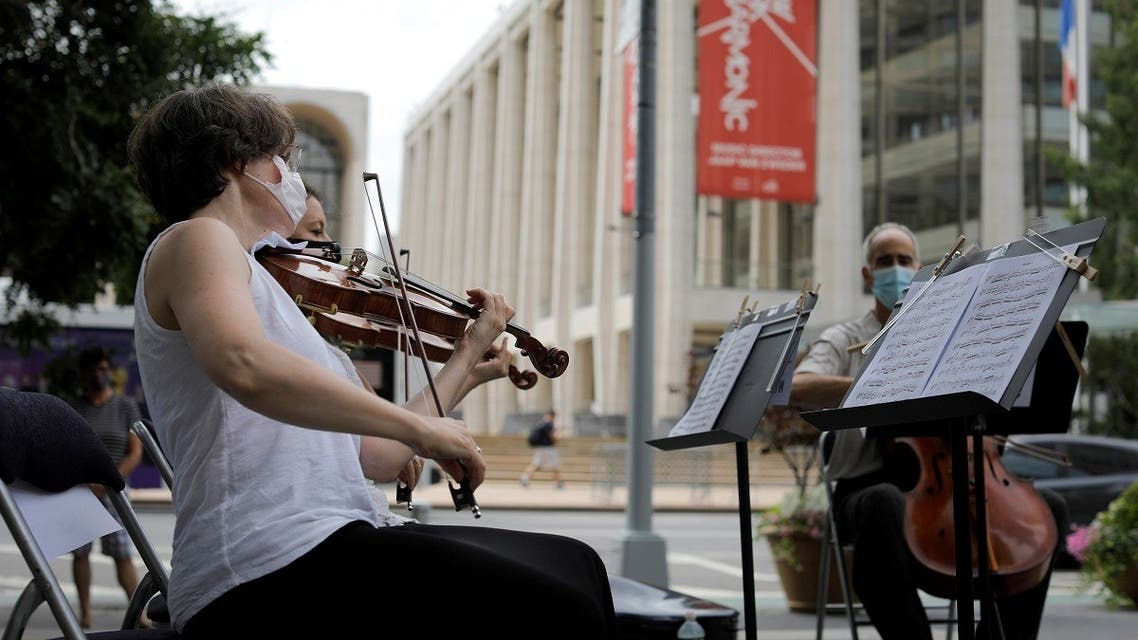 A string quartet made up of musicians from the New York Philharmonic Orchestra play first public performance since March in New York. (Reuters)