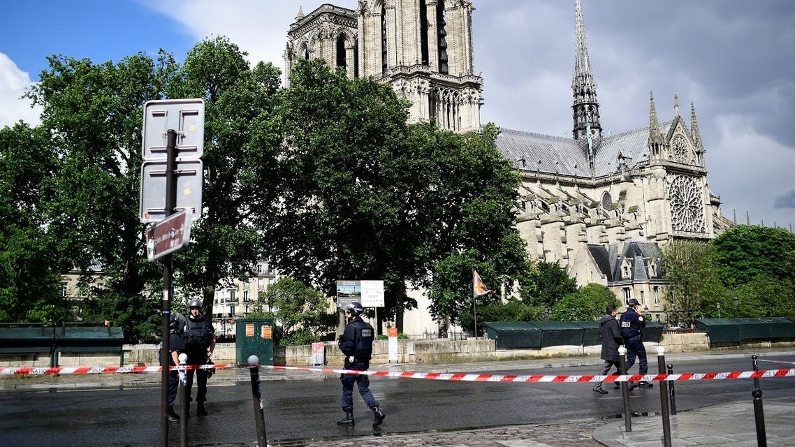 In this file photo taken on June 6, 2017, French police gather at a cordoned-off area at Notre-Dame Cathederal in Pari, as a French police officer shot and injured Farid Ikken, an Algerian who attacked him with a hammer outside the cathedral. (AFP)