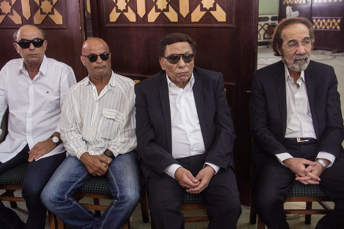 Egyptian actors Mahmoud Yassin, right, and Adel Imam, second right, attend the funeral of well-known Egyptian actor Nour el-Sherif at the Police Mosque in Cairo, Egypt, August 12, 2015. (AP/Ibrahim Ezzat)