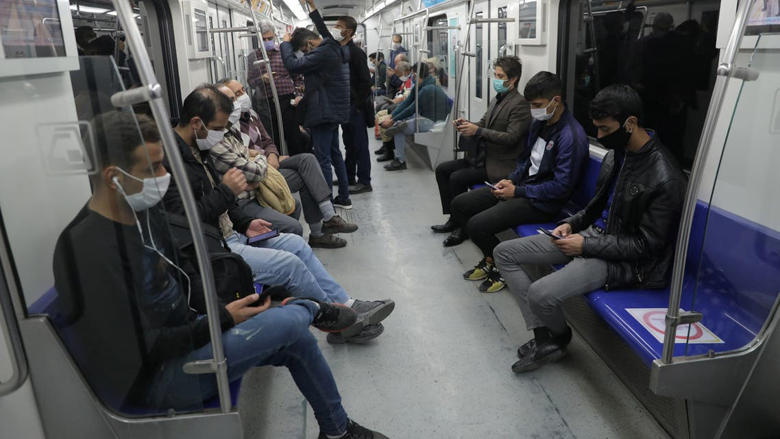 Iranian commuters wear face masks in a metro after Iranian authorities made it mandatory for all to wear face masks in public following the outbreak of the coronavirus disease (COVID19), in Tehran Iran October 10, 2020. Majid Asgaripour/WANA (West Asia News Agency) via REUTERS ATTENTION EDITORS - THIS IMAGE HAS BEEN SUPPLIED BY A THIRD PARTY.