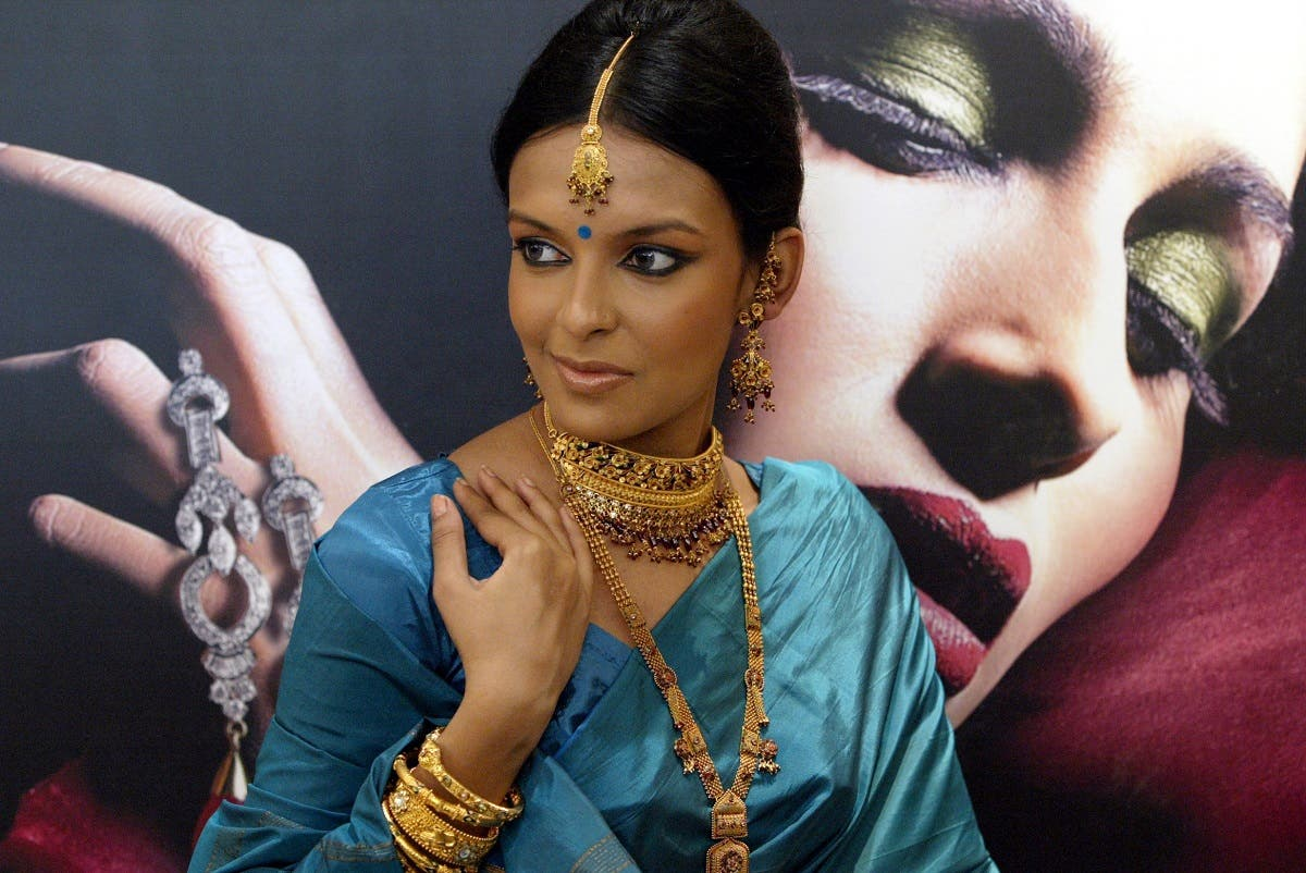 A model displays period and traditional gold jewelry 'Revitalizer of Tradition' at the launch of a concept jewelry store by Tanishq in Calcutta, India. (AP)