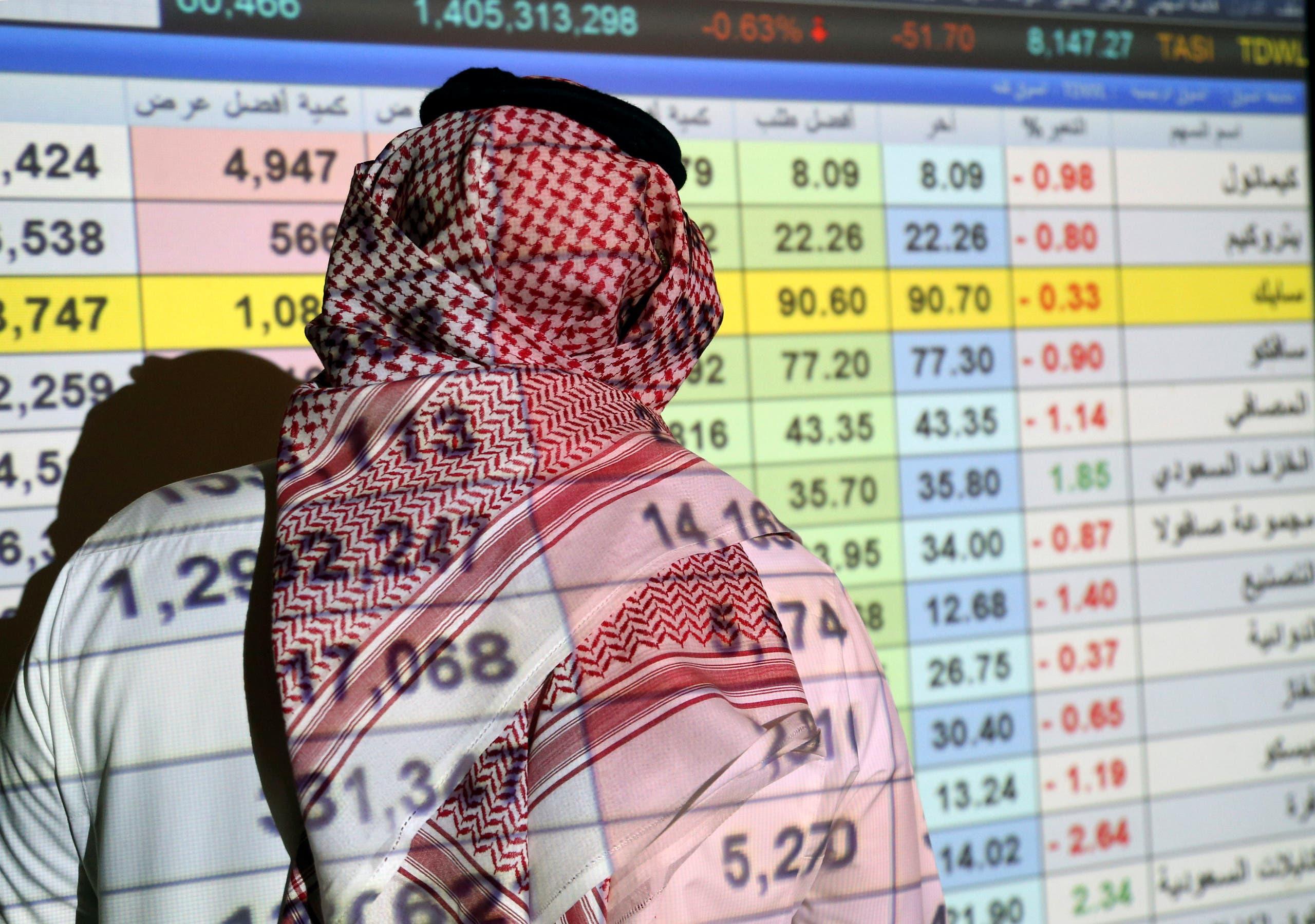 A Saudi trader monitors stocks at the Saudi stock market in Riyadh, Saudi Arabia, January 8, 2020. (Reuters)