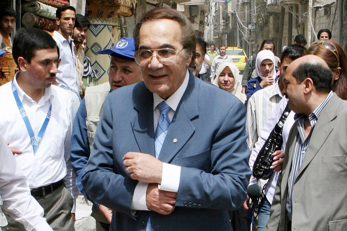 A file photo shows Egyptian actor Yassin, a Good Will Ambassador of the WFP, tours a suburb in Damascus, to check the conditions of Iraqi refugees in Syria, April 15, 2008. (AP Photo/Bassem Tellawi)