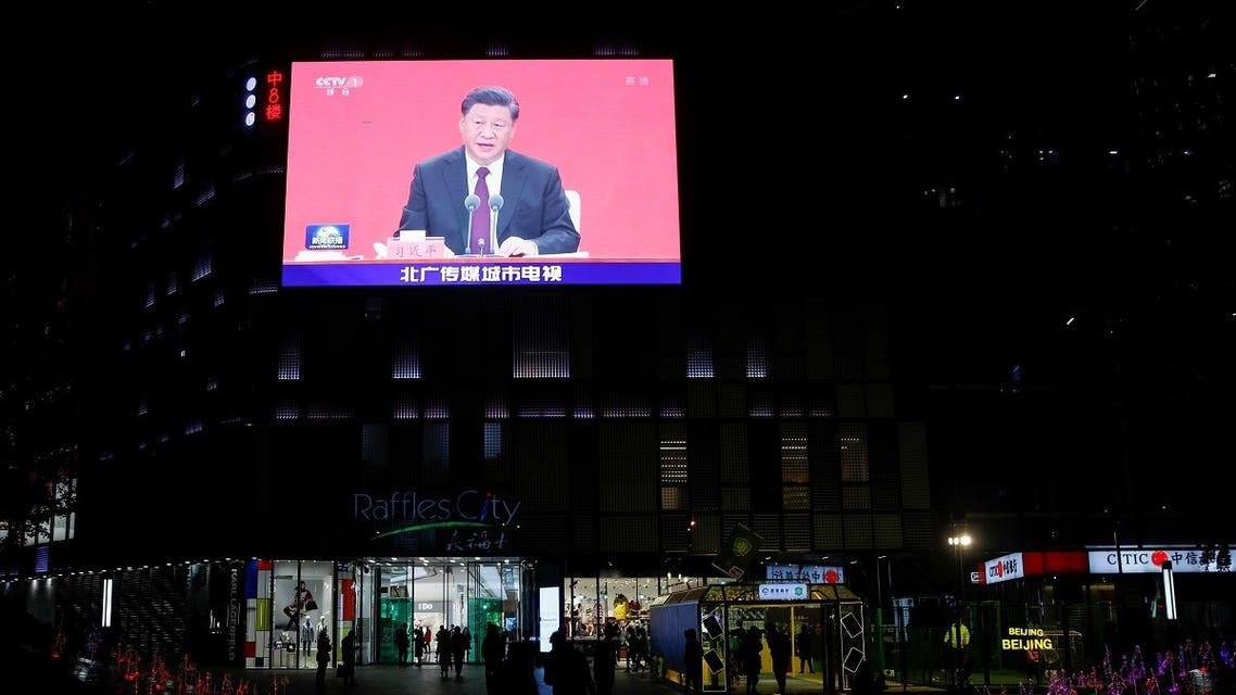 A giant screen shows news footage of Chinese President Xi Jinping speaking at an event marking the 40th anniversary of the establishment of Shenzhen Special Economic Zone, outside a shopping mall in Beijing, China, on October 14, 2020. (Reuters)