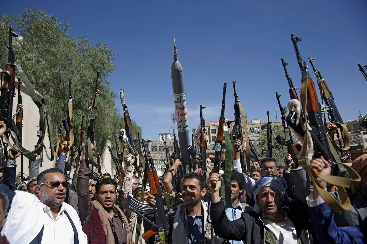 Houthis raise weapons as they chant slogans during a gathering aimed at mobilizing more fighters in Sanaa, Yemen, February, 25, 2020. (AP)