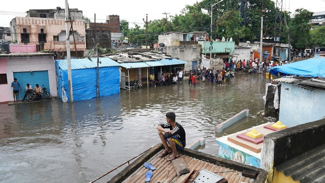 People are seen in a flooded residential area after heavy rainfall in Hyderabad, the capital of the southern state of Telangana, India, on October 14, 2020. (Reuters)_2111886462_RC2BIJ9IKUU4_RTRMADP_3_INDIA-FLOODS