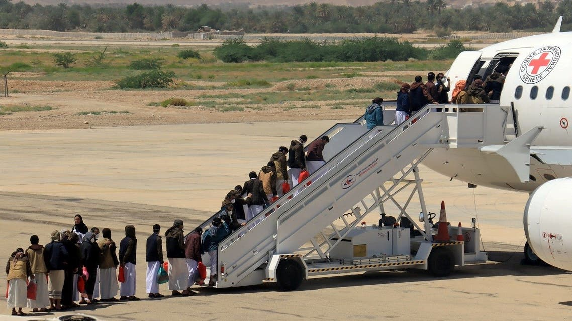 Houthi prisoners board a plane before heading to Sanaa airport after being released by the Saudi-led coalition in a prisoner swap, at Sayoun airport. (Reuters)