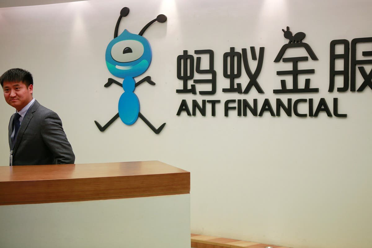 An employee stands next to the logo of Ant Financial Services Group, Alibaba's financial affiliate, at its headquarters in Hangzhou, Zhejiang province, China. (Reuters)