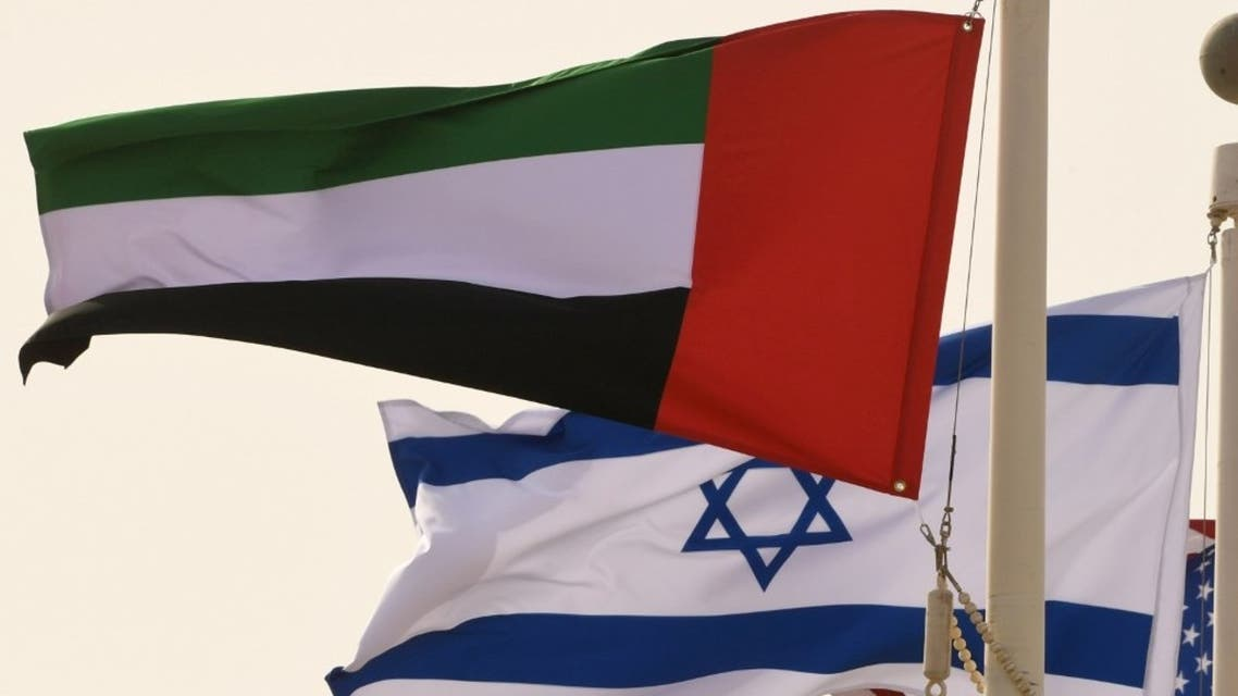 The Emirati, Israeli and US flags sway in the wind at the Abu Dhabi airport at the arrival of the first-ever commercial flight from Israel to the UAE, on August 31, 2020. (AFP)