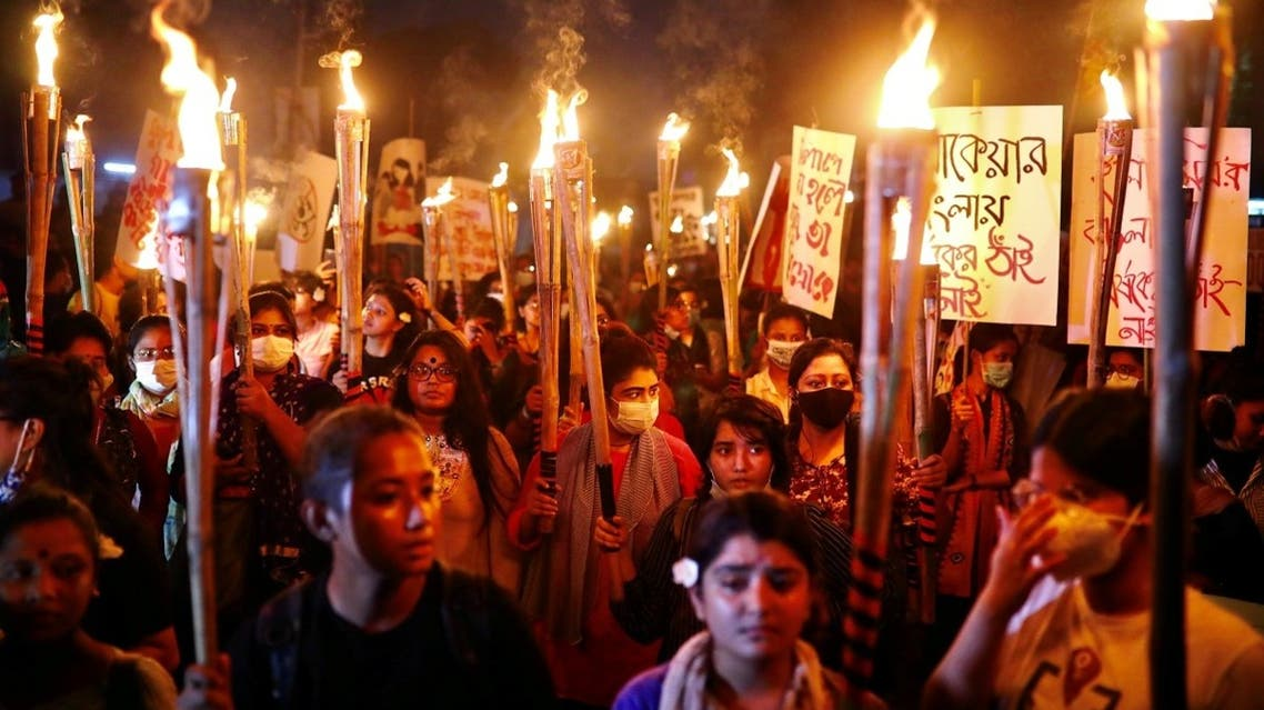 Female activists and students take part in a torch procession demanding women's safety and justice for rape victims in Dhaka, Bangladesh, on October 14, 2020. (Reuters)