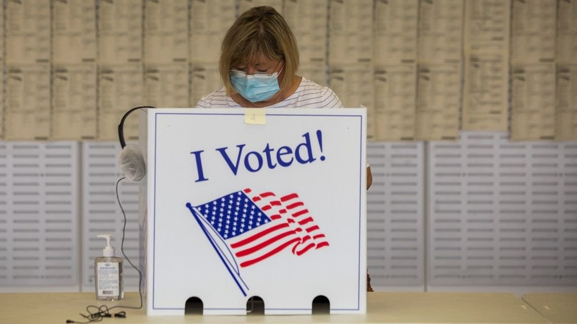 A woman casts her ballot for the upcoming presidential election during early voting in South Carolina, Oct. 9, 2020. (Reuters)
