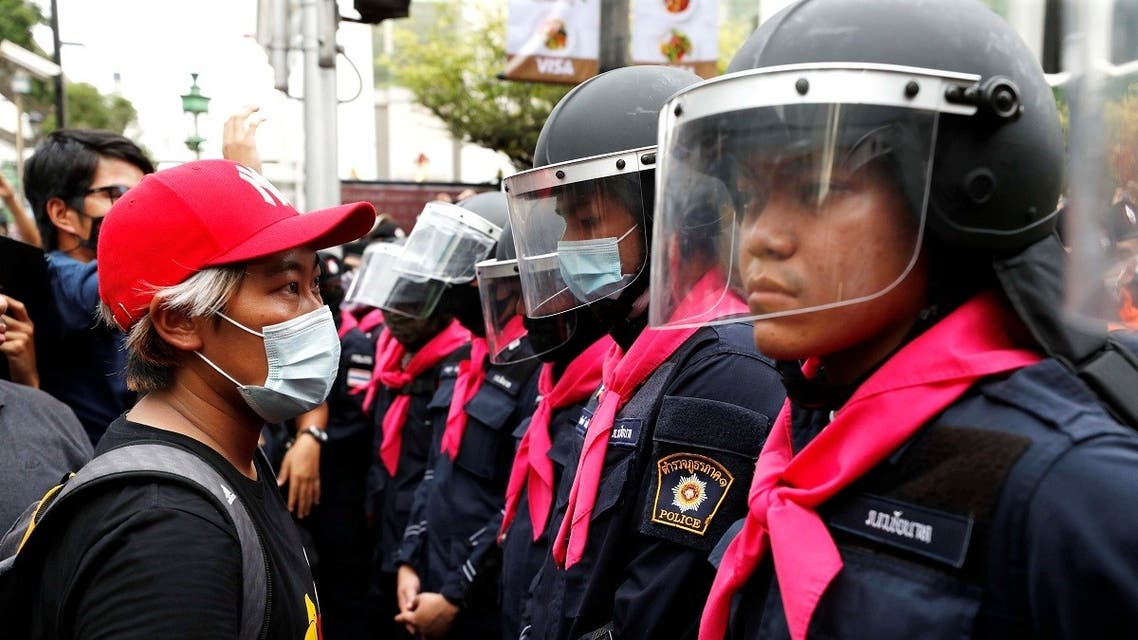 A pro-democracy protester stands in front of police officers during anti-government protests in Bangkok, Thailand, on October 15, 2020. (Reuters)