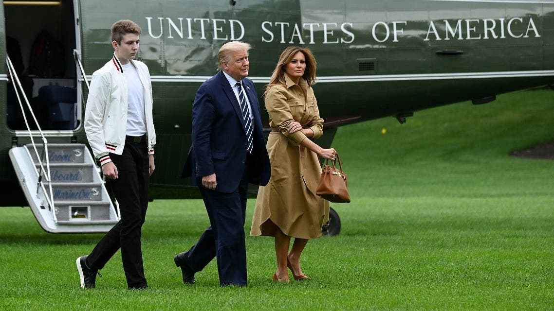 U.S. President Donald Trump, First Lady Melania Trump and their son Barron walk to the White House from Marine One in Washington, U.S. August 16, 2020. (Reuters/Erin Scott)