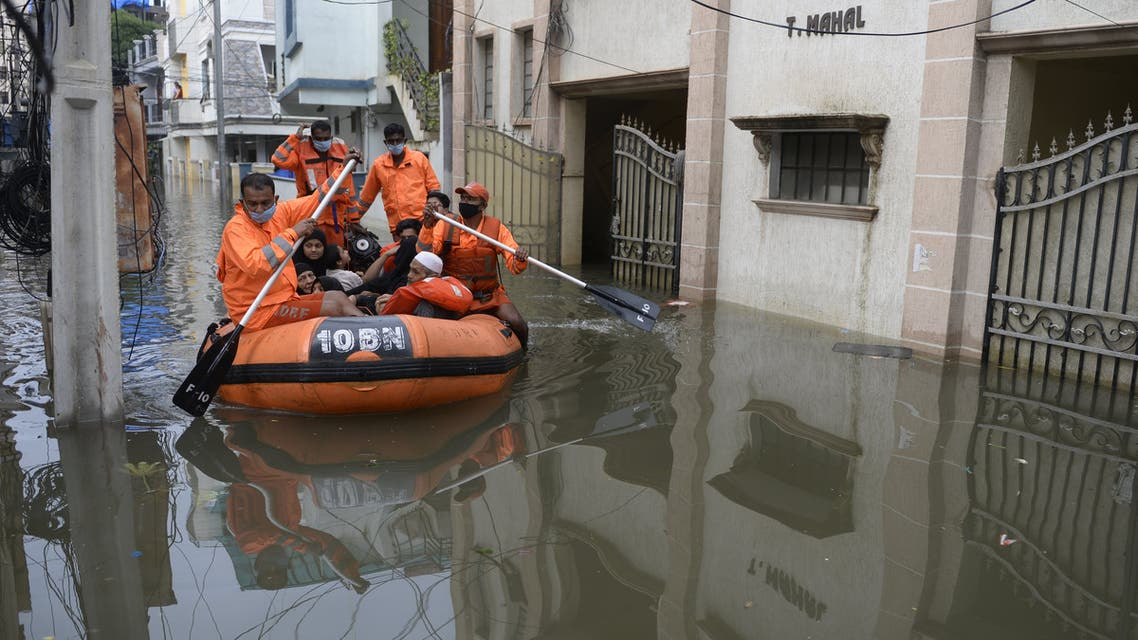 National Disaster Response Force personnel evacuate local residents following heavy rains in Hyderabad on October 15, 2020. (AFP)
