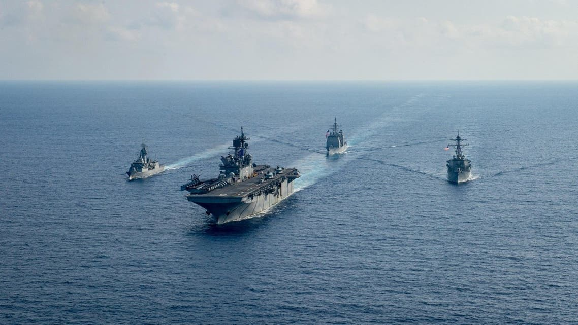 Royal Australian Navy guided-missile frigate HMAS Parramatta (FFH 154) (L) sails with U.S. Navy Amphibious assault ship USS America (LHA 6), Ticonderoga-class guided-missile cruiser USS Bunker Hill (CG 52) and Arleigh-Burke class guided missile destroyer USS Barry (DDG 52) in the South China Sea, April 18, 2020. (Reuters)