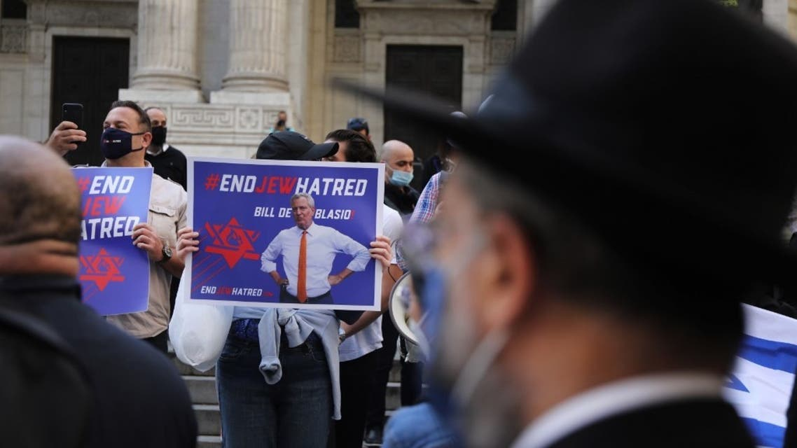 Protesters rally in Manhattan against the closing of some schools and businesses in Jewish neighborhoods in the Brooklyn and Queens boroughs due to a spike in the numbers of Covid-19 cases in these neighborhoods on October 15, 2020 in New York City. (AFP)