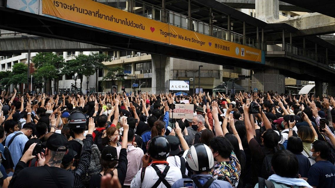 Pro-democracy protesters show the three-finger salute as they gather demanding the government to resign and to release detained leaders in Bangkok, Thailand, on October 15, 2020. (Reuters)