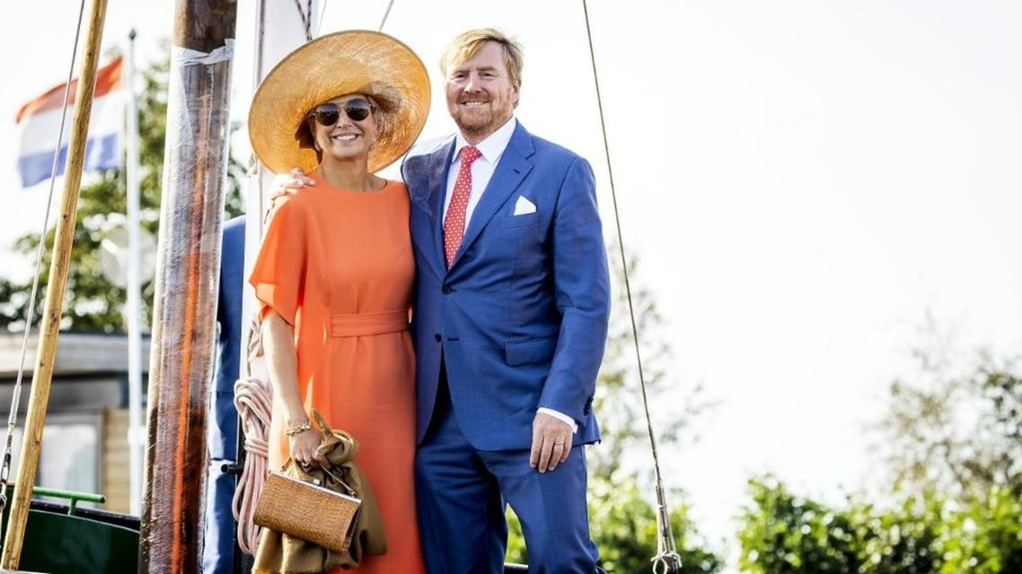 King Willem-Alexander of the Netherlands (R) and Queen Maxima of the Netherlands pose during a visit to a sailing school De Veenhoop in Veenhoop, the Netherlands on September 17, 2020. (AFP)