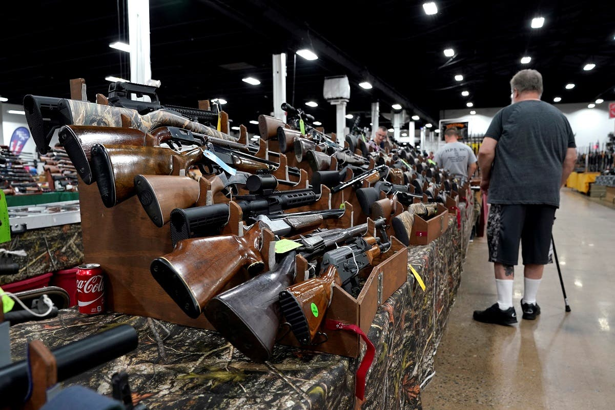 A man looks at rifles displayed for sale at the Guntoberfest gun show in Oaks, Pennsylvania, Oct. 6, 2017. (File Photo: Reuters)