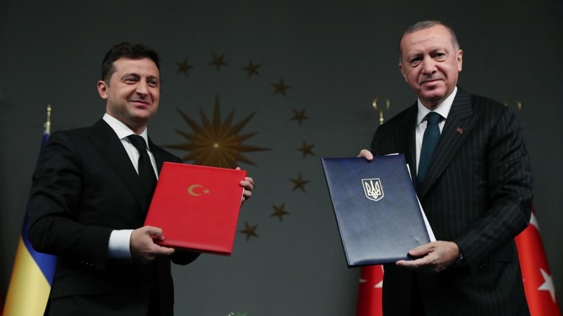 This handout photograph released by the Turkish Presidential Press Service on October 16,2020 shows Turkish President Tayyip Erdogan (R) and his Ukrainian counterpart Volodymyr Zelenskiy (L) attending a signing ceremony in Istanbul. (AFP)