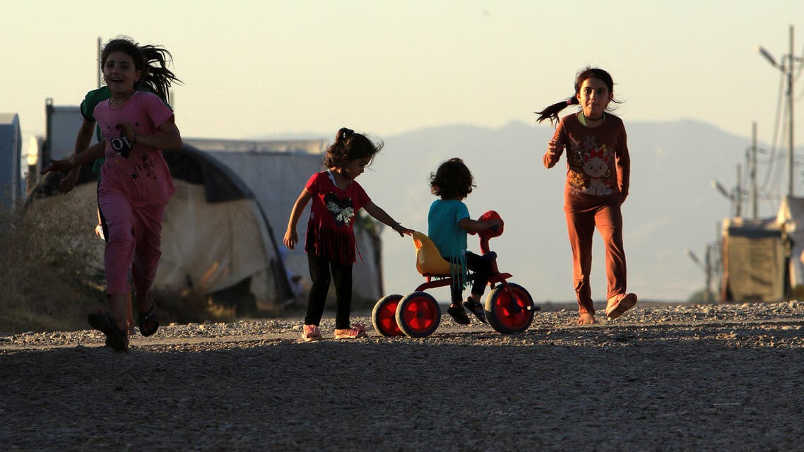 Displaced Iraqi children from the minority Yazidi sect, who fled the Iraqi town of Sinjar, play at the Khanki camp on the outskirts of Dohuk province, July 31, 2019. Picture taken July 31, 2019.  (Reuters)