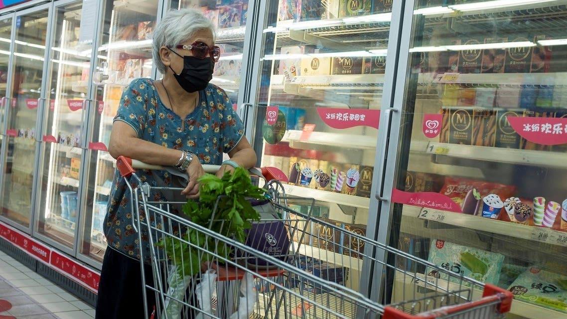 A file photo shows a woman looks at frozen food products in a supermarket in Beijing, China, August 13, 2020. (Reuters/Thomas Peter)