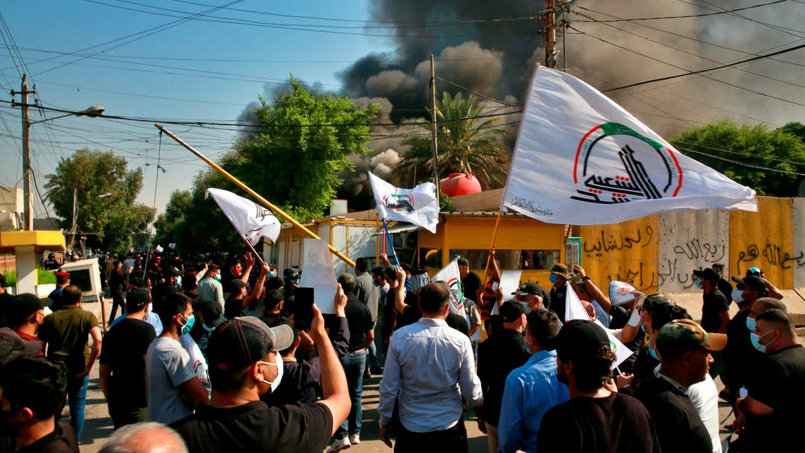 The headquarters of Kurdish Democratic Party burn during a protest by pro-Iranian militiamen and their supporters in Baghdad, Iraq, Saturday, Oct. 17, 2020. (AP)