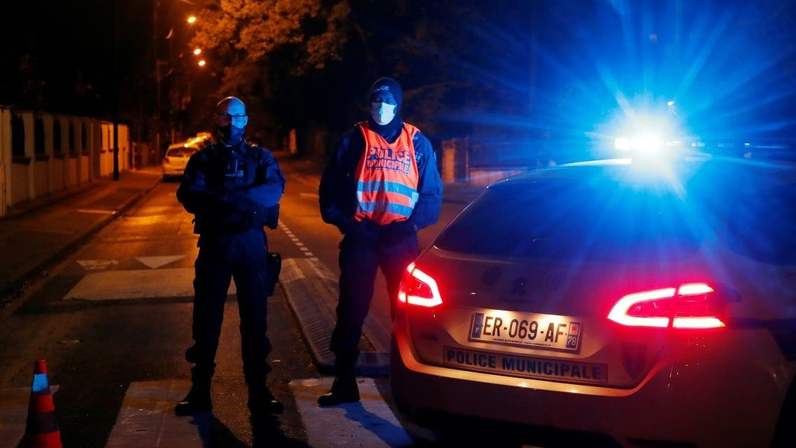 Police officers secure the area near the scene of a stabbing attack in the Paris suburb of Conflans St Honorine, France, October 16, 2020. (Reuters)