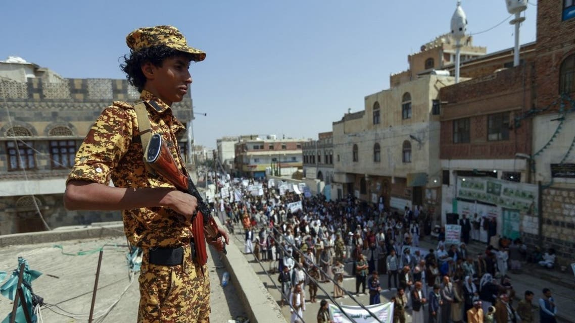 A fighter loyal to Yemen's Huthi rebels stands guard during a rally commemorating the death of Shia Imam Zaid bin Ali in the capital Sanaa, on September 14, 2020. (AFP)