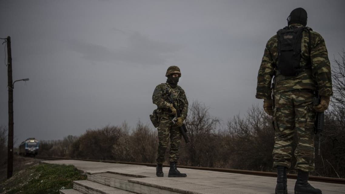 Greek army officers patrol at the railway station of Kastanies village, near the Greek-Turkish border on March 8, 2020. (AFP)