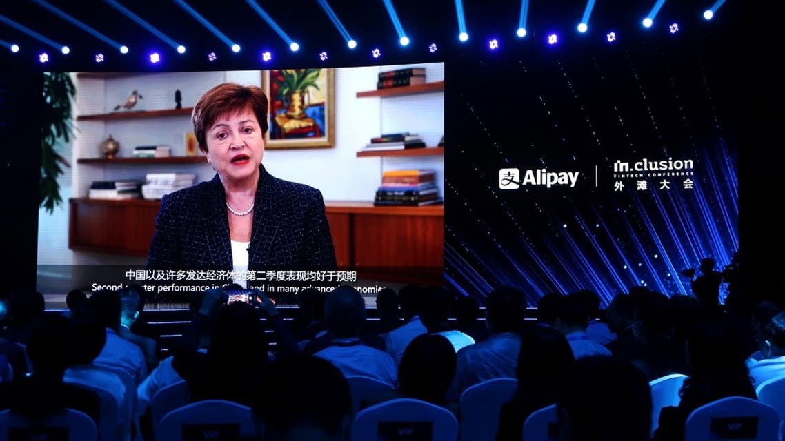 Kristalina Georgieva, Managing Director of the International Monetary Fund (IMF), is seen on a giant screen as she delivers a speech via video at the INCLUSION Fintech Conference in Shanghai, China, September 24, 2020. (Reuters/Cheng Leng)