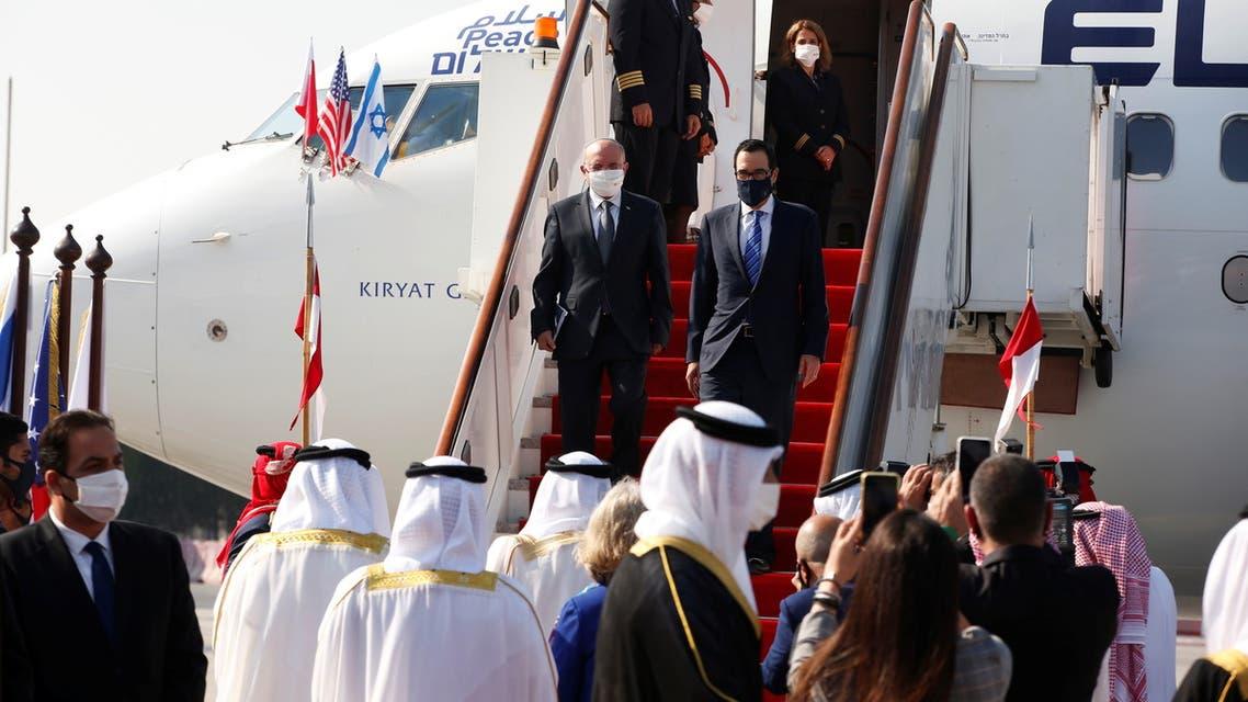 Israeli National Security Adviser Meir Ben-Shabbat, U.S. Treasury Secretary Steve Mnuchin, and Bahrain's Foreign Minister Abdullatif Al Zayani, deliver statements upon the Israeli delegation's arrival in Muharraq, Bahrain October 18, 2020. REUTERS/Ronen Zvulun/Pool