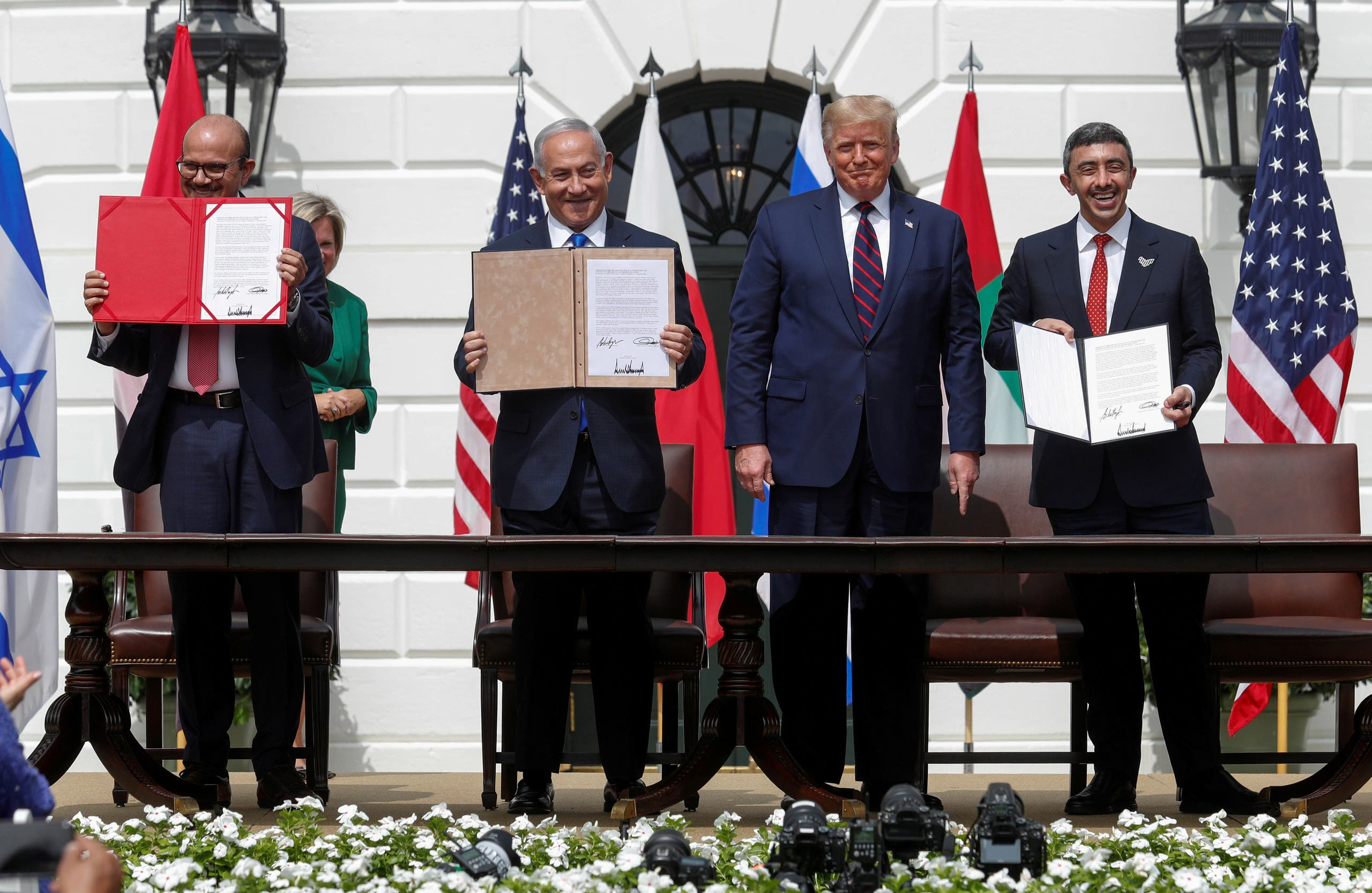Bahrain's Foreign Minister Abdullatif Al Zayani, Israel's Prime Minister Benjamin Netanyahu and United Arab Emirates (UAE) Foreign Minister Abdullah bin Zayed display their copies of signed agreements. (Reuters)