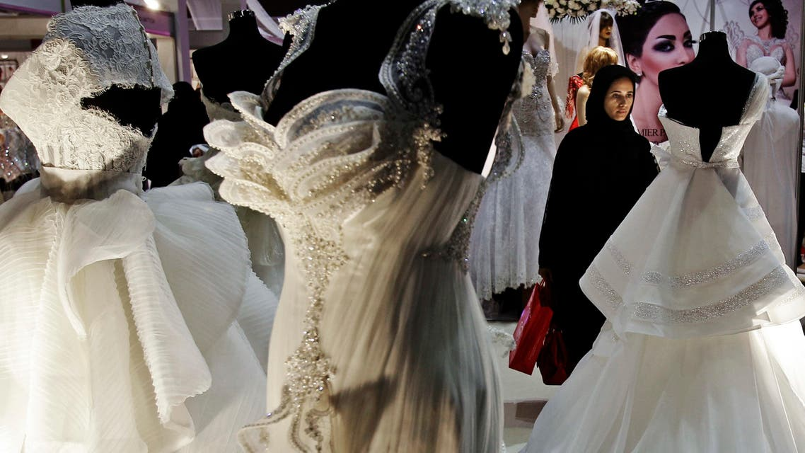 In this Saturday, April 13, 2013 photo, an Emirati woman looks at wedding gowns at a bridal exhibition in Dubai, United Arab Emirates. (File photo: AP)